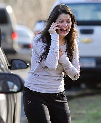 A Newtown woman reacts with horror, disbelief and anguish In this iconic photo