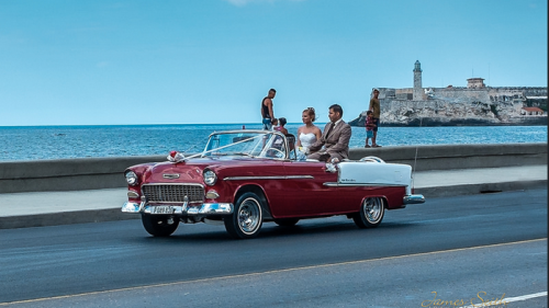 1955 Chevy on El Malecón in Havana, Cuba, with El Morro Castle
