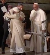 Pope Francis watches Rabbi and Imam embrace
