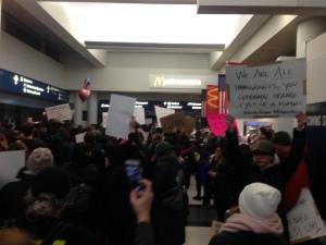 Anti-Trump protesters flood O'Hare Terminal 5 on Saturday.   Matthew Hendrickson/Sun-Times